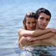 Couple hugging in the water — Stock Photo
