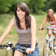 Portrait of two girls on bikes — Stock Photo #8477447