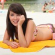Brunette basking in the sun - Stock Photo