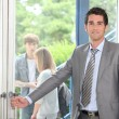 Royalty-Free Stock Photo: Teacher opening door
