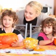 Family carving pumpkins together — Stock Photo #8477686