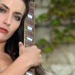 Stock Photo: Womoutdoors with guitar
