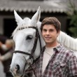 Portrait of a young man with horse — Stock Photo