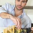 Young man playing chess — Stock Photo #8478501