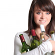 Young woman holding empty wine bottles — Stock Photo