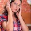 Royalty-Free Stock Photo: A woman listening to music
