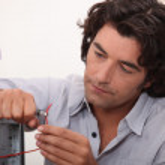 Man fixing a hard drive — Stock Photo #8479118