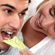 Stock Photo: Womgiving her boyfriend salad