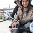 Young couple having motorbike ride — Stock Photo #8479502
