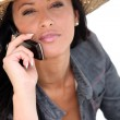 Beautiful woman talking on her cell phone — Stock Photo