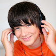 Teenage boy listening to music — Stock Photo #8479918