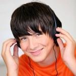 Teenage boy listening to music — Stock Photo #8479918