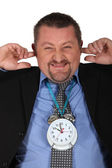 Man blocking his ears because of alarm clock — Stock Photo