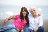 Young woman spending time with grandma — Stock Photo