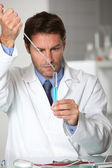 Laboratory technician working with a test tube — Stock Photo