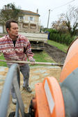 Man with a cement mixer — Stock Photo
