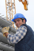 Construction worker with slabs of reinforced concrete — Stock Photo