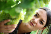 Young woman inspecting grape harvest — Stock Photo