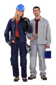 Female electrician with male painter — Stock Photo