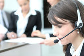 Young receptionist with headset — Stock Photo