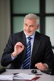 Senior businessman thinks everything is OK — Stock Photo