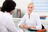 Young woman meeting employer — Stock Photo