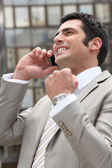 Businessman overjoyed with his phone call — Stock Photo
