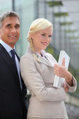 Director and assistant standing outdoors — Stock Photo