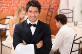Waiter in restaurant — Stock Photo