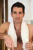 Portrait of a man with bath towel — Stock Photo