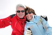Couple on snowy mountain — Stock Photo