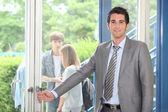 Teacher opening door — Stock Photo