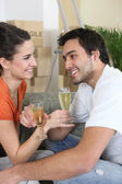 Drinking champagne in new home — Stock Photo