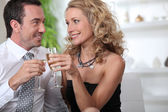 Couple celebrating with a glass of champagne — Stock Photo
