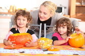 Family carving pumpkins together — Stock Photo