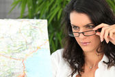 Brunette looking at map — Stock Photo