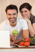 Couple reading mails at breakfast — Stock Photo