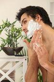 Man applying shaving foam — Stock Photo