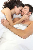 Couple asleep in bed — Stock Photo