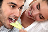Woman giving her boyfriend a salad — Stock Photo