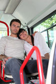 Couple sitting on a bus — Stock Photo