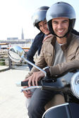 Young couple having a motorbike ride — Stock Photo