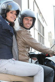 Couple of bikers with crash helmet — Stock Photo