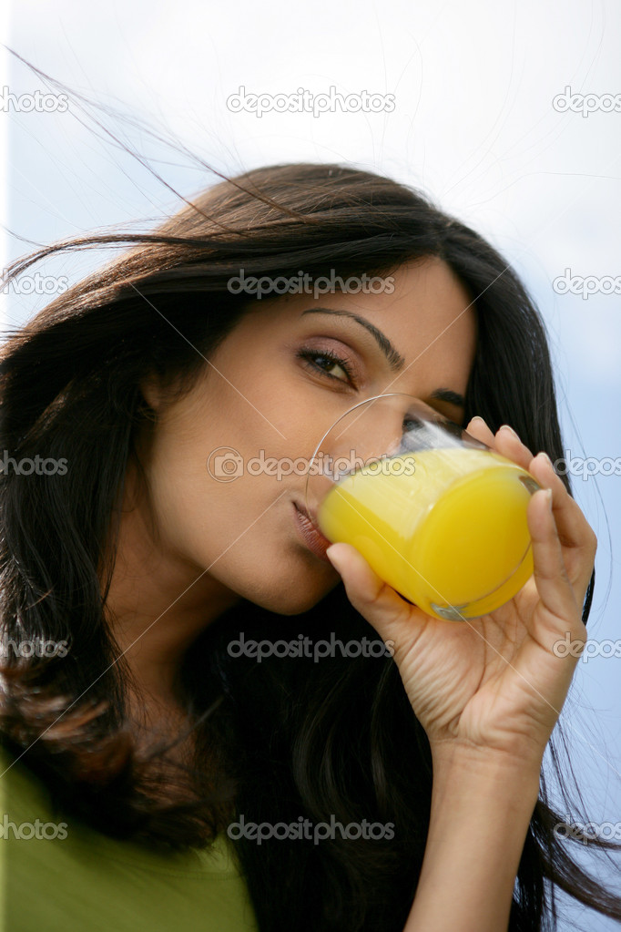 Gorgeous woman drinking orange juice — Stock Photo #8477983