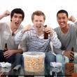 Buddies watching football match on telly — Stock Photo