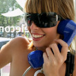 Young womin telephone booth — Stock Photo #8480144