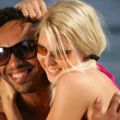 Portrait of a young couple at the beach — Stock Photo