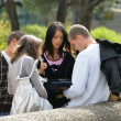 Students looking at a rucksack — Stock Photo