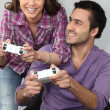 Couple playing video games — Stock Photo #8481540