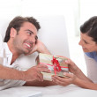 Man offering gift to woman — Stock Photo #8481844